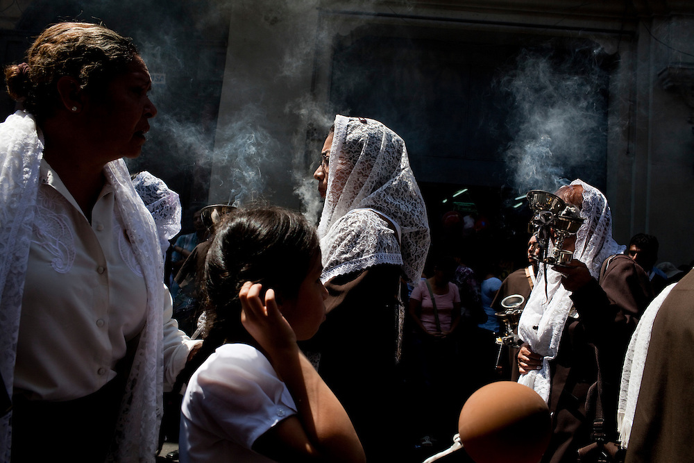 A girl watches an Easter procession on Sunday, Apr. 12, 2009 in Lima, Peru.
