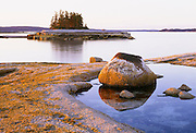 0903-1007F ~ Copyright:  George H. H. Huey ~ Sunset on the ledges of Devil Island. One of thirty small silands that comprise Merchants Row, between Deer Isle and Isle au Haut. Jericho Bay, Hancock County, Maine.