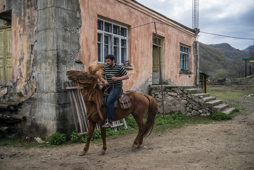 VANK, NAGORNO-KARABAKH - APRIL 18: David Baghdasaryan rides a Karabakh horse on April 18, 2015 in Vank, Nagorno-Karabakh. Since signing a ceasefire in a war with Azerbaijan in 1994, Nagorno-Karabakh, officially part of Azerbaijan, has functioned as a self-declared independent republic and de facto part of Armenia, with hostilities along the line of contact between Nagorno-Karabakh and Azerbaijan occasionally flaring up and causing casualties. (Photo by Brendan Hoffman/Getty Images) *** Local Caption *** David Baghdasaryan