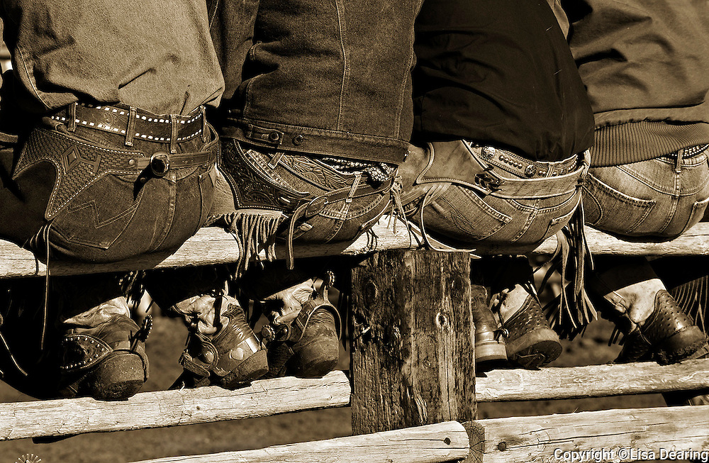 Cowboys Sitting on Fence at Ranch Rodeo