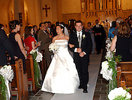 Nicole Lee Pugliese and William Patrick Garvey stroll down the aisle after their wedding ceremony at St. Joseph's Church in Bronxville, NY on Friday, July 26, 2002. <br />