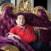 BEJING, JUNE 2013 : Multi -Millionaer Li Xiaohua in seinem Pekinger Penthouse. Li war China's erster Ferrari Fahrer und u.a. das Vorzeigesymbol fuer viele auslaendische Staatsgaeste. Li ist jetzt im Ruhestand und widmet sich hauptsaechlich dem Pekinger Elite Club, der von ihm gegruendet wurde.