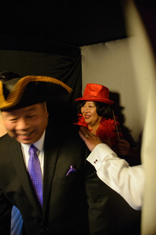 Photo by Matt Roth.Assignment ID: 30140754A..Evelyn Hsieh's parents Ann and Paul Hsieh exit the photo booth after having their photos made with the bride and groom during Evelyn Hsieh and Michael Wong's reception at the the Mount Vernon Inn, in Mount Vernon, Virginia on Saturday, April 06, 2013.