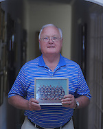 Former Ole Miss football player and high school coach Gerald Morgan holds a photo of the 1965 Drew High School football team he coached, in Oxford, Miss. on Monday, September 20, 2010. Morgan coached Archie Manning at Drew.