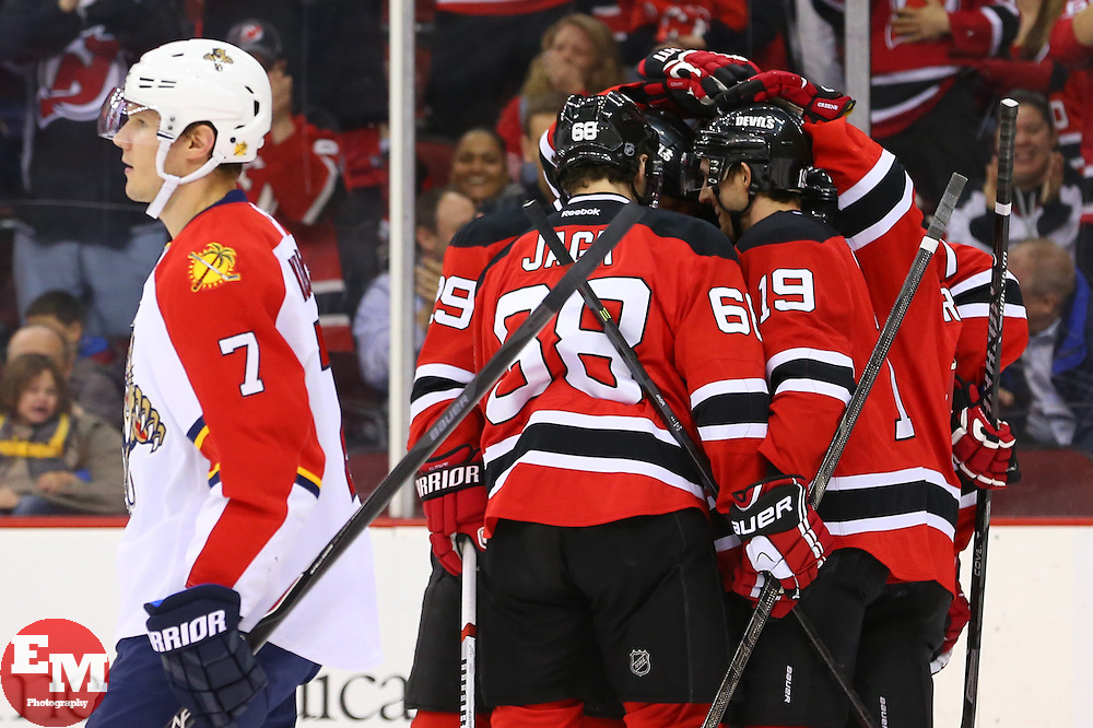 Mar 31, 2014; Newark, NJ, USA; The New Jersey Devils celebrate a goal by New Jersey Devils center Travis Zajac (19) during the first period at Prudential Center.