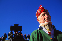 WWII veteran at a German cemetery, near-Omaha beach