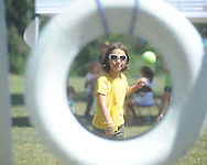 "Cecile Roberts throws a ball towards a tire during St. Peter's Episcopal Church's ""Fun in the Country"" in Oxford, Miss. on Monday, September 6, 2010."