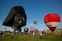 """2011 Great Reno Balloon Race 1"" - These hot air balloons and Darth Vader balloon were photographed during the 2011 Great Reno Balloon Race."