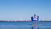 Women with flag on Stand up Paddle Board September 12, 2016