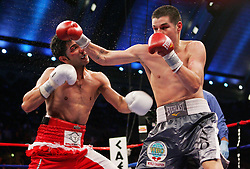 October 18, 2008; Atlantic City, NJ, USA;  Steven Luevano (gray trunks) and Billy Dib (white/red trunks) trade punches during their 12 round WBO World Featherweight Championship fight at Boardwalk Hall in Atlantic City, NJ.  Luevano won the fight via unanimous decision.