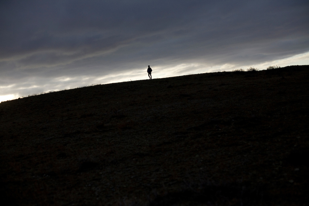 CREDIT: DOMINIC BRACCO II..SLUG:PRJ/KAZAKHSTAN SHEEP HERDERS..DATE:10/22/2009..CAPTION:Zhumatai Muzdybayev walks up onto a hill for a better view of his sheep near Semey, Kazakhstan. The herders live near a radio active lake which was made during the 1970s as part of an experiment by the USSR to create lakes from atomic bombs. The lake is in an area known as The Polygon, a test site for more than 400 of the Soviet Union's nuclear weapons.