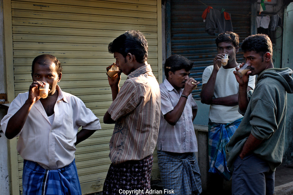 In the early morn men drink chai on 12th Dec 2006. Chai is an indian style of tea, very sweet and boiled with milk and a variety of spices, it is the drink that fuels the country.