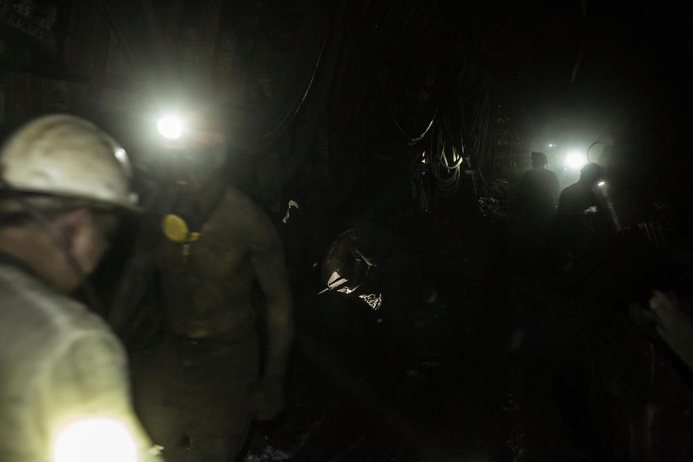Miners walk through a tunnel 1300 meters underground at the Shcheglovskaya Coal Mine on Friday, March 25, 2016 in Makiivka, Ukraine.