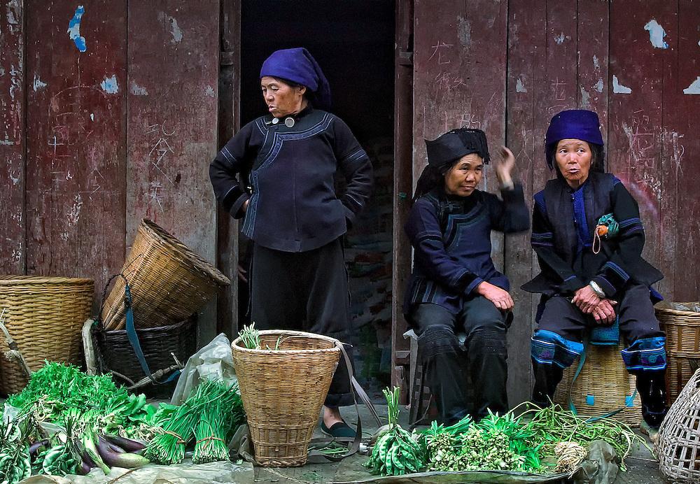 Hani woman  at the market selling their farm grown produce in Yuanyang, Yunnan, China.