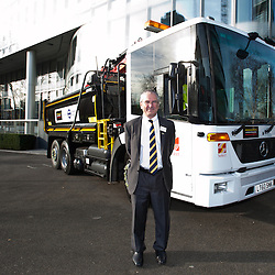 London, UK - 9 december 2013: Sir Peter Hendy, CBE, commissioner of Transport of London stands next to a new construction lorry with vastly improved driver visibility and safety equipment nearby City Hall.