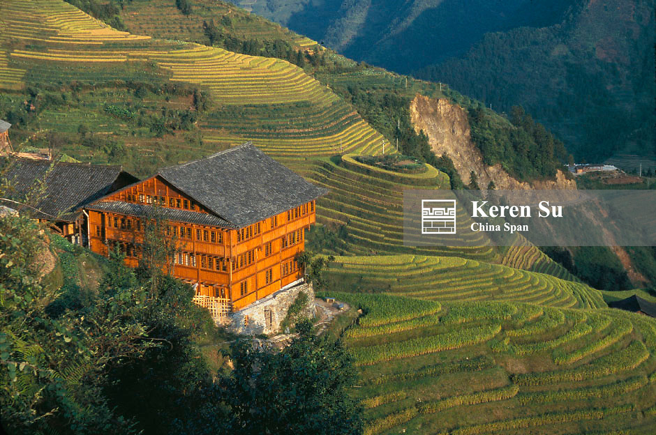 Traditional wood lodge among terraced rice paddy in the mountain under sunset, Longsheng, Guangxi Province, China