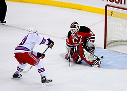 March 19, 2008; Newark, NJ, USA;  New York Rangers left wing Nigel Dawes (10) beats New Jersey Devils goalie Martin Brodeur (30) between the pads during the overtime shootout at the Prudential Center. The New York Rangers defeated the New Jersey Devils 2-1 in a shootout.