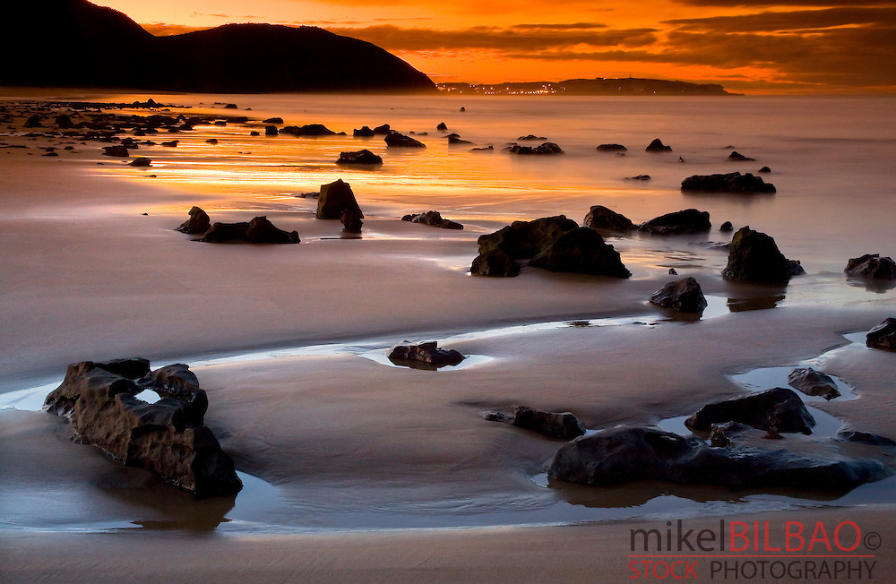 Low tide in Berria beach at sunset..Santoña, Cantabria, Spain
