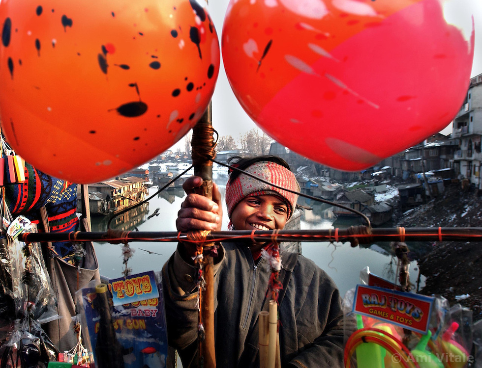 A boy sells toys on a bridge in central Srinigar in the Indian held state of Kashmir. Kashmir was once a tourist hot spot but since a militant movement began 12 years ago, the tourists have been replaced by soldiers. Despite the tension and constant threat of attacks most Kashmiri people manage to keep their dream of a peaceful future and a sense of humor.