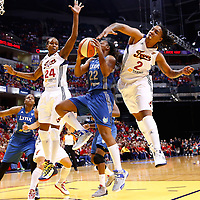 INDIANAPOLIS, IN - OCTOBER 21: Monica Wright #22 of the Minnesota Lynx shoots the ball as Tamika Catchings #24 of the Indiana Fever and Erlana Larkins #2 of the Indiana Fever defends during Game Four of the 2012 WNBA Finals on October 21, 2012 at Bankers Life Fieldhouse in Indianapolis, Indiana. NOTE TO USER: User expressly acknowledges and agrees that, by downloading and or using this Photograph, user is consenting to the terms and conditions of the Getty Images License Agreement. (Photo by Michael Hickey/Getty Images) *** Local Caption *** Monica Wright; Tamika Catchings; Erlana Larkins