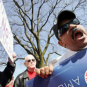 Harold Elder, right, of Columbus and Bob Andras, left, of Plain City vocalize their opinions of a healthcare bill during a protest outside of U.S. Rep. Mary Jo Kilroy's office on Olentangy River Road on March 16. Elder was in support of healthcare legislation, while Andras was in opposition.