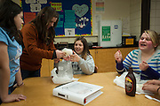 Mentors work with students at Garry Middle School (Photo by Gonzaga University)