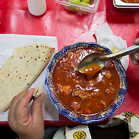 Menudo, a soup of tripe and chili served with lime, chili and tortilla. Merced Market, Mexico City, Mexico