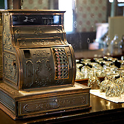 An old cash register in the saloon, part of a 30 building  re-creation based on Wisconsin villages a century ago. ..Horse Drawn Days was held Saturday, June 12, 2010 at Stonefield Historic Site near Cassville, Wisconsin.