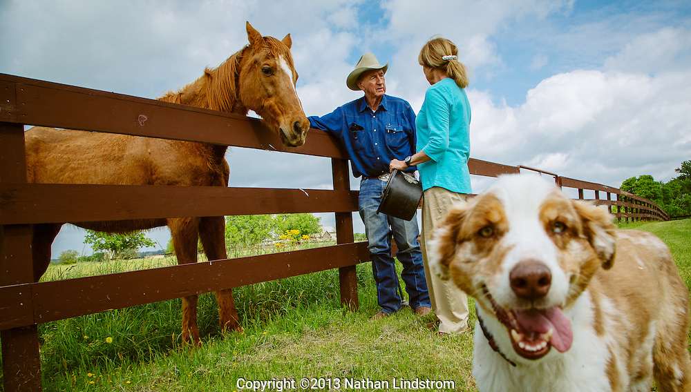 A cowboy discuss his duties with the farm owner. Country lifestyle.<br /> Photographed by editorial lifestyle photographer Nathan Lindstrom