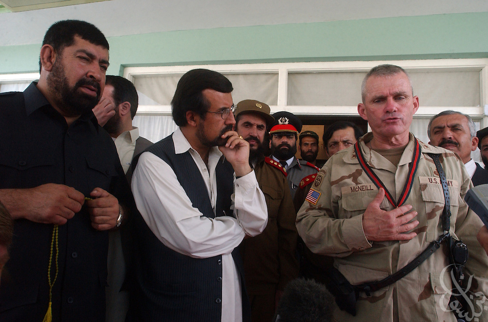 Coalition Joint Task Force (CJTF) 180 Commander General Dan McNeill speaks to reporters after meeting with  Kandahar regional governor Gul Agha Sherzai (l) July 21, 2002 in Kandahar, Afghanistan. Sherzai had previously endorsed a plan that would require U.S. forces to seek permission of local authorities before launching military operations in the central and southern provinces of Afghanistan. Other local governors refused to back the plan, and after today's meeting with McNeill, Sherzai appears to have backed away from the idea..
