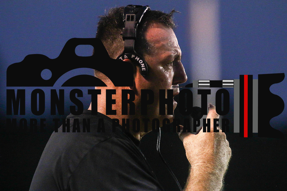 William Penn head coach Marvin Dooley speaks into his headset during a week one DIAA game between  William Penn and St. Georges, Friday, Sept. 09, 2016 at CARAVEL Academy in Bear, DE.