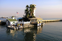 """Forbes Island -  Created as a floating home in 1975 the 100 foot long island  features live palm trees, a sand patio, a waterfall and a thatched Tahitian room. The lighthouse is complete with a viewing deck for visitors to marvel at San Francisco Bay views.  Forbes Thor Kiddoo started his career in the Coast Guard then began work as a carpenter going into business constructing floating homes with wood homes on top.  Receiving his inspiration from """"20,000 Leagues Under the Sea"""", Forbes got the idea to build his own island paradise and launched Forbes Island in 1980."""