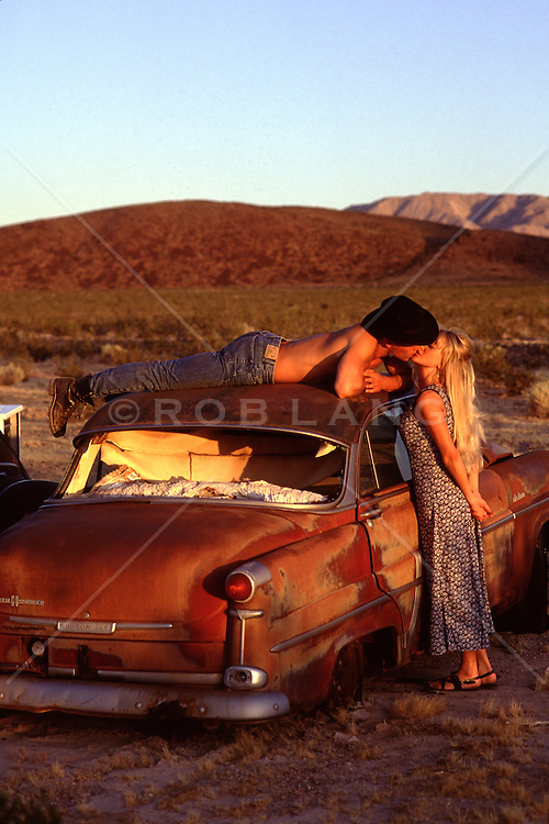 Hot Cowboy Kissing A Girl By An Abandoned Car In The