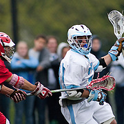 05/18/2011- Medford/Somerville, Mass. - Tufts attack Andrew Fiamengo (A13) catches a check from Cortland State midfielder Eric Parah in the Jumbos 10-9 win over Cortland State in the NCAA Tournament Quarterfinals at Bello Field on May 18, 2011. (Kelvin Ma/Tufts University)