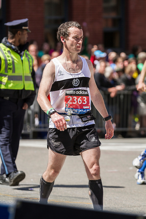 2014 Boston Marathon: runner stumbles toward the finish line after briefly passing out