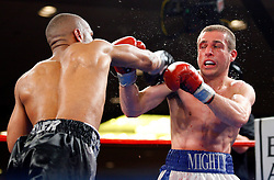 May 9, 2008; Atlantic City, NJ, USA;  Champion Mike Arnaoutis (white/blue trunks) and challenger Lanardo Tyner (black/gray trunks) trade punches during their 12 round USBA Junior Welterweight Championship bout at Bally's Ballroom in Atlantic City, NJ.  Arnaoutis retained his title via 12 round unanimous decision.