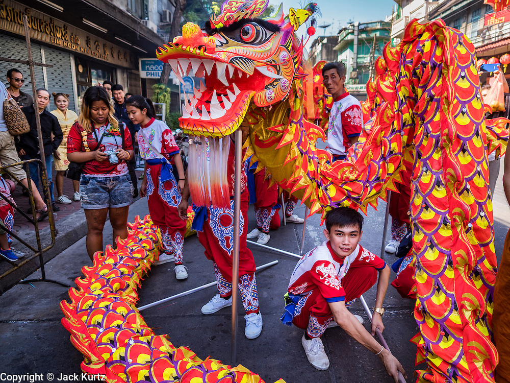 27 JANUARY 2017 - BANGKOK, THAILAND: A member of a Chinese dragon dance troupe relaxes after a performance at a Chinese Shrine in Bangkok on Chinese New Year. 2017 is the Year of the Rooster in the Chinese zodiac. This year's Lunar New Year festivities in Bangkok were toned down because many people are still mourning the death Bhumibol Adulyadej, the Late King of Thailand, who died on Oct 13, 2016. Chinese New Year is widely celebrated in Thailand, because ethnic Chinese are about 15% of the Thai population.       PHOTO BY JACK KURTZ