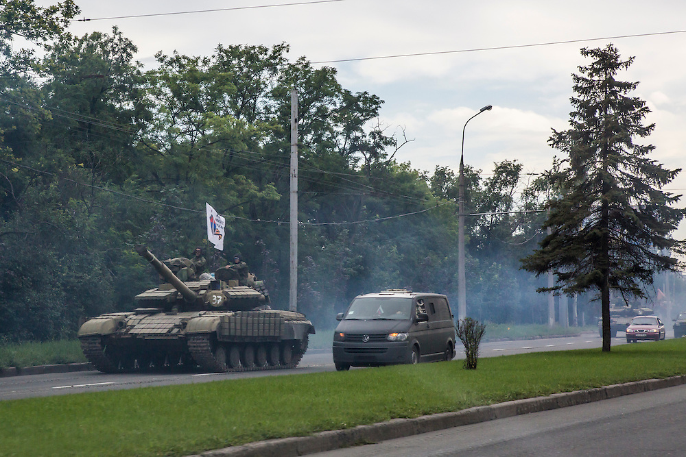 DONETSK, UKRAINE - JULY 21: Pro-Russia rebels travel in a convoy of tanks and transport vehicles as fighting escalates in the city following the crash of Malaysia Airlines flight MH17 on July 21, 2014 in Donetsk, Ukraine. Malaysia Airlines flight MH17 was travelling from Amsterdam to Kuala Lumpur when it crashed killing all 298 on board including 80 children. The aircraft was allegedly shot down by a missile and investigations continue over the perpetrators of the attack. (Photo by Brendan Hoffman/Getty Images) *** Local Caption ***