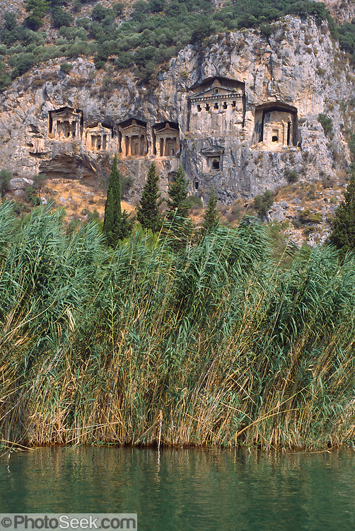 "Lycian tombs (or necropoli) from about 400 BCE can be seen by boat on the Dalyan Çay? River, above the ancient harbor city of Caunos, on the Turquoise Coast, near the town of Koycegiz, in southwest Turkey. Dalyan means ""fishing weir"" in Turkish. The Dalyan Delta, with a long, golden sandy beach at its mouth, is a nature conservation area and a refuge for sea turtles (Caretta caretta) and blue crabs. Image published in the travel handbook ""Moon Istanbul & the Turkish Coast"" by Jessica Tamtürk, Avalon Travel Publishing, 2010."