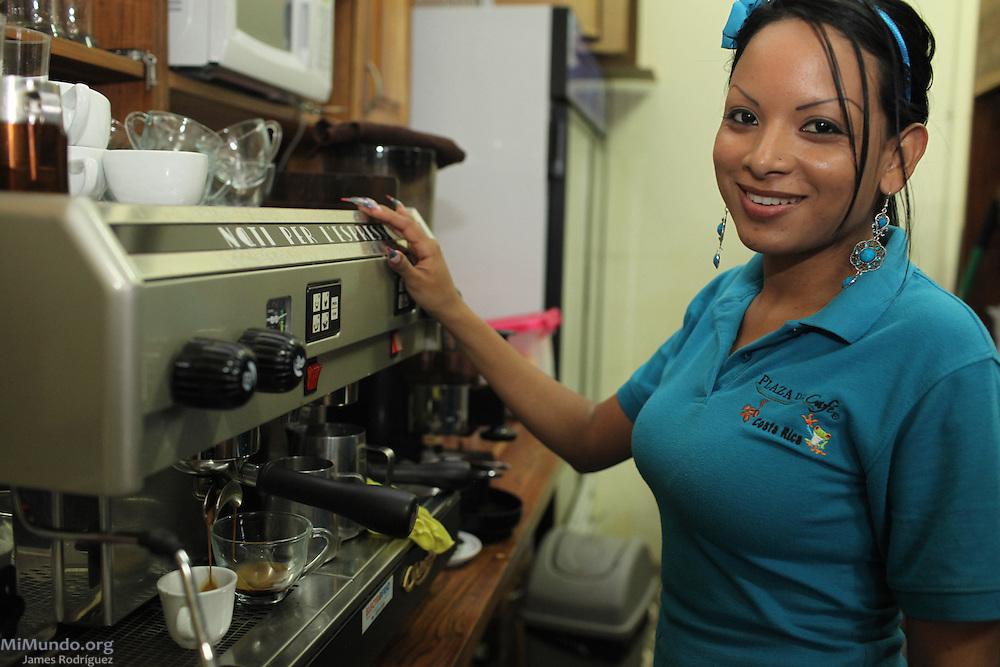 Jeannethe Escalante Rodríguez, coffee shop server at COOCAFE's Plaza del Café Restaurant in the port city of Puntarenas, prepares a hot coffee drink. COOCAFE, Puntarenas, Puntarenas, Costa Rica. August 22, 2012.