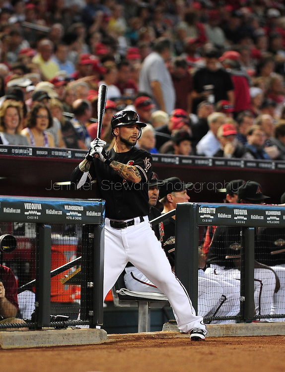 Jun. 18 2011; Phoenix, AZ, USA; Arizona Diamondbacks batter Ryan Roberts (14) reacts while playing against the Chicago White Sox at Chase Field. The White Sox defeated the Diamondbacks 6-2. Mandatory Credit: Jennifer Stewart-US PRESSWIRE.