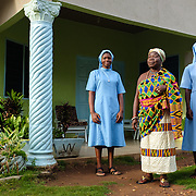 Mama Agblatsu III (centre), is a Queen Mother in Bankoe, a traditional division in the town of Ho in the Volta Region of Ghana. A devout Catholic, she asked to be photographed with two nuns from her church.
