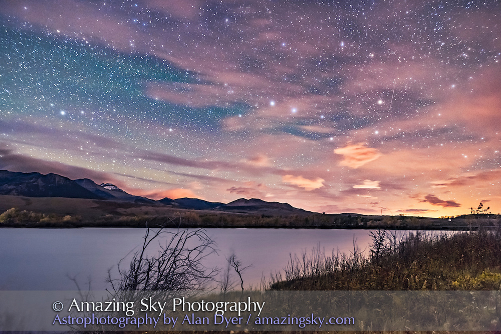 The Big Dipper in hazy clouds over the Waterton River at Maskinonge Pond, September 23, 2016, taken at the Night Photography Workshop I conducted there that night. The glow at right is light pollution from the Shell Waterton Gas Plant and from Pincher Creek to the north. <br />