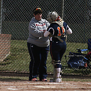 Delmar Wildcats manager Michelle Niblett, LEFT, Delmar Wildcats Catcher Alison Pusey (11) unjust her padding during a varsity schedule game between Caravel Academy and The Delmar Wildcats Saturday, April 4, 2015, at Caravel Athletic Field in Bear Delaware.