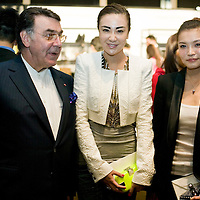 BEIJING, MAY-22 :  a Balmain client poses for a picture  with Alain Hivelin (L) , CEO of Balmain ,  during the cocktail invitation before the Balmain spring/summer 2012 show.