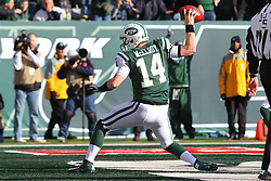 Dec 23, 2012; East Rutherford, NJ, USA; New York Jets quarterback Greg McElroy (14) celebrates his first down run during the first half of their game against the San Diego Chargers at MetLIfe Stadium.