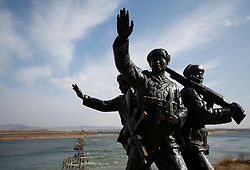 Sculptures of Chinese soldiers are seen along the Yalu River bank where across lies the border of North Korea near the town of Sinuiji across the Chinese city of Dandong, Liaoning Province, China on 06 April 2013. North Korean leader Kim Jong-un has ordered the country's military to increase artillery production, a televised report out of Pyongyang showed 06 April.