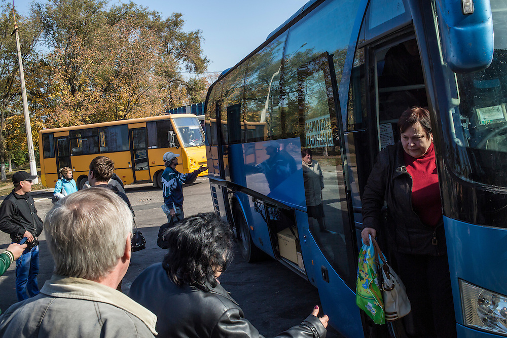 MARIUPOL, UKRAINE - OCTOBER 13: People disembark from a bus just arriving from Donetsk on October 13, 2014 in Mariupol, Ukraine. The United Nations has registered more than 360,000 people who have been forced to leave their homes due to fighting in the East, though the true number is believed to be much higher.(Photo by Brendan Hoffman/Getty Images) *** Local Caption ***