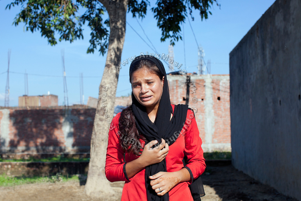 """Afreen, 17, a member of the Red Brigades, is crying during a street play promoting awareness about women's condition in India, on the streets of Madiyaw colony, Lucknow District, Uttar Pradesh. The Red Brigades are a group of young women led by Usha, 25, who after an attempted rape began talking about abuse with her students, aged around 14 to 18 years old. Usha founded the Red Brigades in November 2010. They perform in self-written plays on gender equality around villages and cities, take part to protests and also teach self-defence classes. Most of the girls in the group have experienced some kind of abuse in their past. They sing words such as """"all sisters are breaking all the rules, boundaries, come to bring a new world, change will come,"""" and """"for how long do we have to go through this?"""" and """"the country has freedom, but girls do not have freedom."""""""