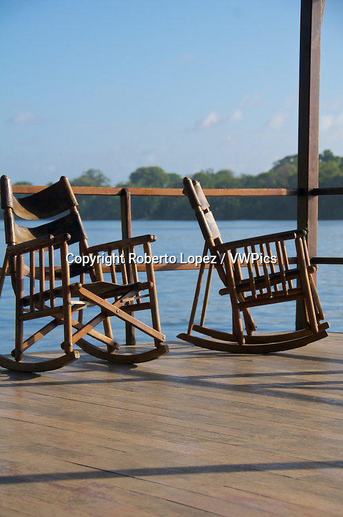 Pair of rocking chairs with a peaceful view of the Tortuguero River at the Mawamba Lodge, Costa Rica